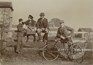 People posing on a fence, c 1901-1910