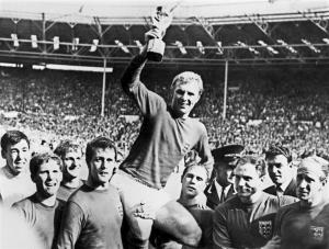 LONDON, UNITED KINGDOM - JULY 30: England's national soccer team captain Bobby Moore holds aloft the Jules Rimet trophy as he is carried by his teammates following England's victory over Germany (4-2 in extra time) in the World Cup final 30 July 1966 at Wembley stadium in London.(From L : Gordon Banks, Alan Ball, Roger Hunt, Geoff Hurst - who scored three goals - , Ray Wilson, George Cohen and Bobby Charlton) AFP PHOTO (Photo credit should read STAFF/AFP/Getty Images)