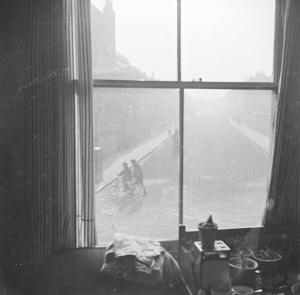 Photograph of children playing in the street taken through a window [1949-54] Nigel Henderson 1917-1985 The papers were acquired by the Tate Archive from Janet Henderson and the Henderson family in 1992. http://www.tate.org.uk/art/archive/TGA-9211-9-6-92-1